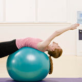 Young woman streches at gym Royalty Free Stock Photos