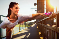 Young woman streching before sports. urban sport style Stock Photo