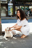 Young woman on the street with a dog Stock Image