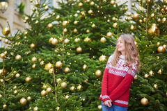 Young woman on a street of Paris decorated for Christmas Royalty Free Stock Images