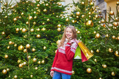 Young woman on a street of Paris decorated for Christmas Royalty Free Stock Photo