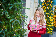 Young woman on a street of Paris decorated for Christmas Stock Photography