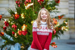 Young woman on a street of Paris decorated for Christmas Stock Photos