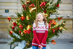 Young woman on a street of Paris decorated for Christmas Stock Images