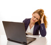 Young woman is stressed due to computer failure. 100 percent pure white background, teen girl is depressed Royalty Free Stock Images
