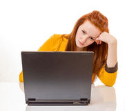 Young woman is stressed due to computer failure. 100 percent pure white background, teen girl is depressed Royalty Free Stock Photography