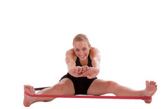 A young woman with a stretch band Stock Image