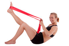 A young woman with a stretch band Stock Photo