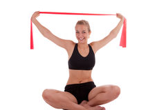 A young woman with a stretch band Royalty Free Stock Image