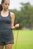 Young woman stretch fitness band exercising outdoor Royalty Free Stock Photo