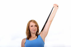 Young woman with stretchband Stock Photo