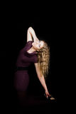 Young woman in stretched pose Royalty Free Stock Photos