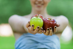 Young woman stretches apples Stock Image