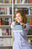 Young woman stretches the book Royalty Free Stock Photos