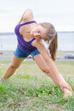 Young woman stretches. Royalty Free Stock Image