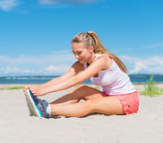 Young woman stretches. Stock Images