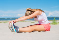 Young woman stretches. Stock Image