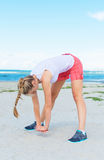 Young woman stretches. Stock Photos