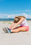 Young woman stretches. Royalty Free Stock Photo