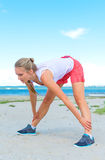 Young woman stretches. Stock Photography