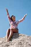 Young woman stretches her hand towards the sky Stock Image