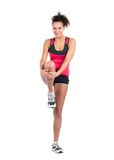 Young woman stretches her musculature Stock Image
