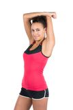 Young woman stretches her musculature Royalty Free Stock Photography