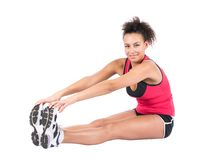 Young woman stretches her musculature Royalty Free Stock Photo