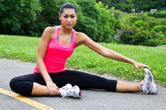Young woman stretches before jogging Stock Photography