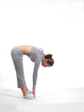 Young Woman Stretching. Young Woman Touching Her Toes Royalty Free Stock Images