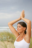 Young woman stretching by the beach Royalty Free Stock Photo