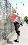 Young woman stretching Stock Image