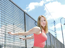 Young woman stretching Royalty Free Stock Image