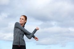 Young woman stretching body muscles Stock Image