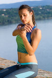 Young woman stretching body outdoor Stock Image