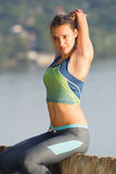 Young woman stretching body outdoor Stock Photos