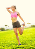 Young woman stretching before exercise Royalty Free Stock Photography