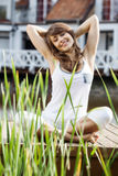 Young woman stretching exercising. Outdoor royalty free stock photos