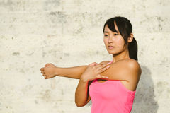 Young woman stretching and exercising Royalty Free Stock Photo