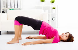 young woman stretching on the floor Stock Images