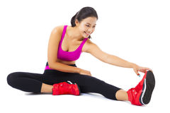 Young woman stretching on the floor Stock Photo