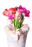 Young woman stretching flowers Royalty Free Stock Photography