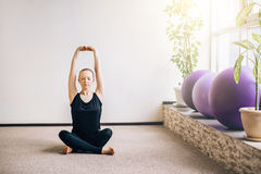 Young woman stretching. And getting ready for her yoga class Royalty Free Stock Photography