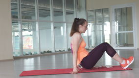 Young woman stretching in gym class. Concept of sport and healthy lifestyle stock footage