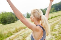 Young woman stretching her arms in the air. As wellnes relaxation exercise Royalty Free Stock Photo