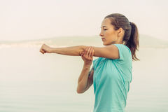 Young woman stretching her arms outdoor Royalty Free Stock Image