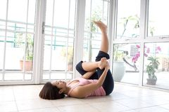 Young woman stretching her calf muscle. As part of exercise routine royalty free stock images