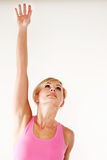 Young woman stretching her hand into the air Royalty Free Stock Images