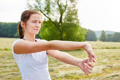 Young woman stretching her hand stock photos