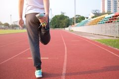 Young woman stretching her legs stock images